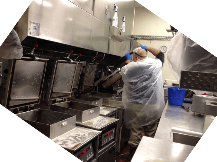 Professional cleaner power washing a commercial kitchen exhaust hood using an antimicrobial solution in Hawaii. Oahu restaurant exhaust hood cleaning Honolulu. Exhaust hood cleaning service in Oahu.
